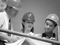 Group of people wearing hard hats